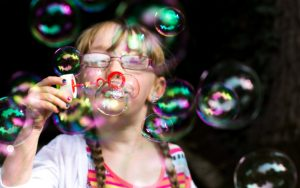 Mel Hudson Family Photography Belfast, little girl blowing bubbles