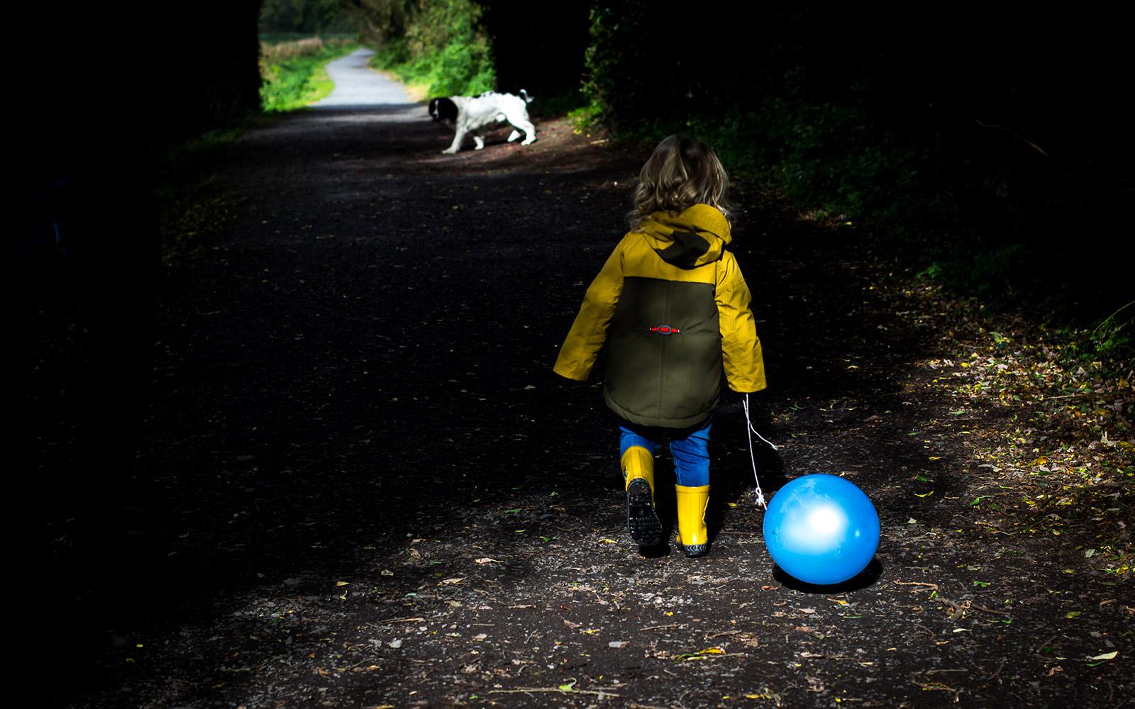 Mel Hudson Family Portrait Photography in Belfast, Little boy walking with his blue balloon