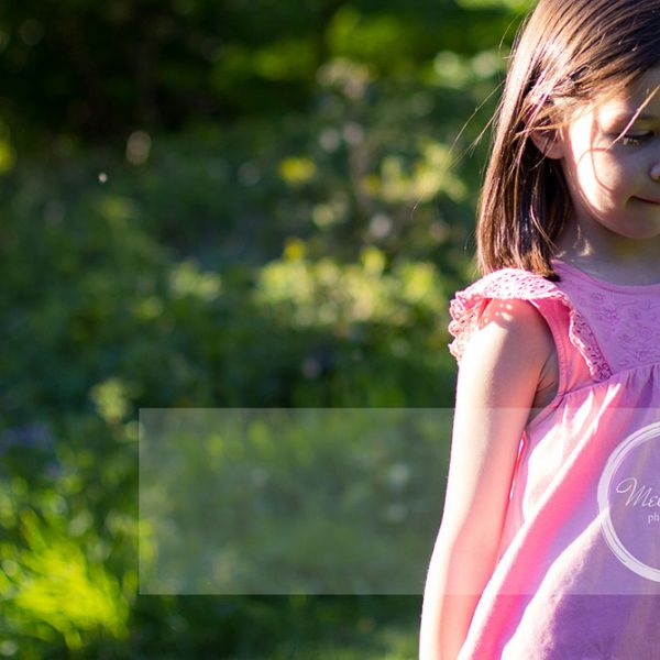 Mel Hudson Family Photography Belfast, young girl in a park in Belfast on a summers evening