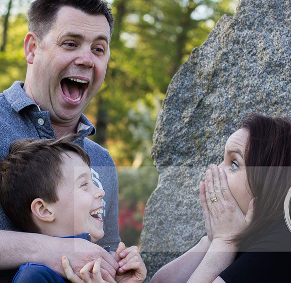 Mel Hudson Family Photography Belfast, young boy with Mum & Dad making them laugh