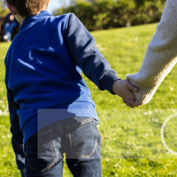 Mel Hudson Family Photography Belfast, young boy leading his mum by the hand