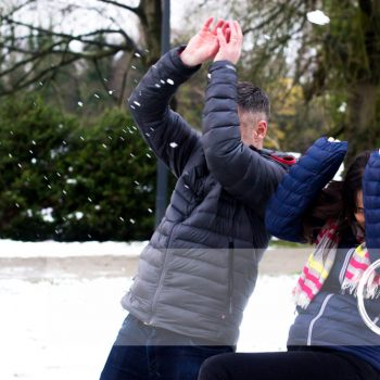 Family Photography Shoot in Ballymena, mum & dad dodging snowballs
