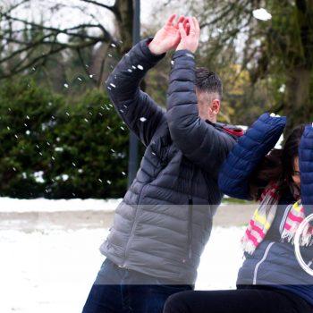 Family Photography Shoot in Ballymena, mum & dad dodging snowballs