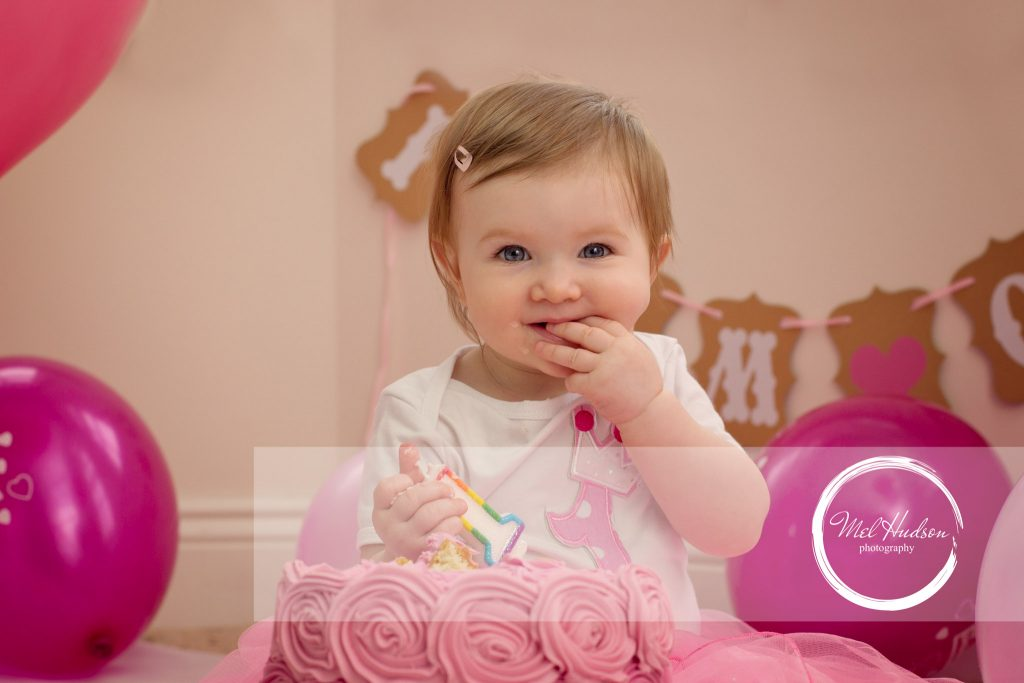 cake smash photography session at home in Hillsborough, Belfast, with pink icing