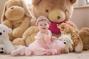 Mel Hudson Family Photography little girl at home with cuddly toys