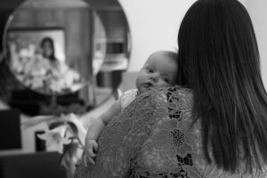 Newborn baby at home family photoshoot, baby looking over mums shoulder