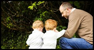 Outdoor family photography, dad and his twin boys exploring