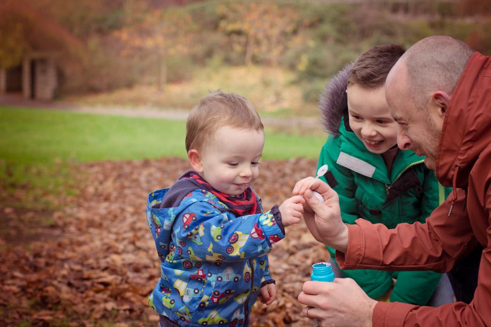 childrens portrait photographer belfast, blowing bubbles at Lady Dixon Gardens Autumn shoot