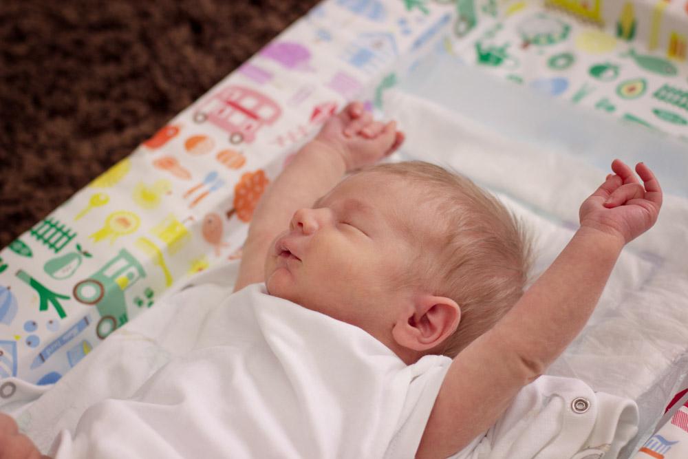 Newborn baby boy stretching