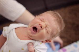 Newborn baby yawns with Mel Hudson Newborn Photographer Co Antrim