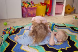 little girl and baby brother during a family at home session with Mel Hudson Photography NI